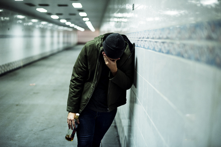 A lonely failure drunk man