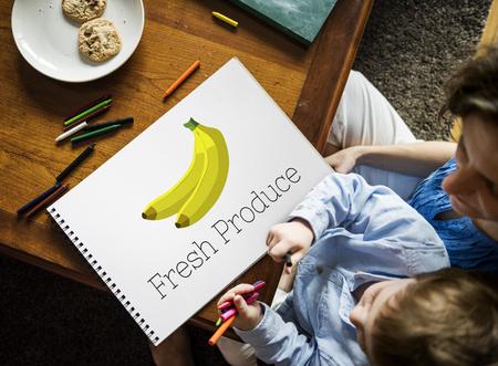 Children with illustration of fresh organic delicious banana Reklamní fotografie