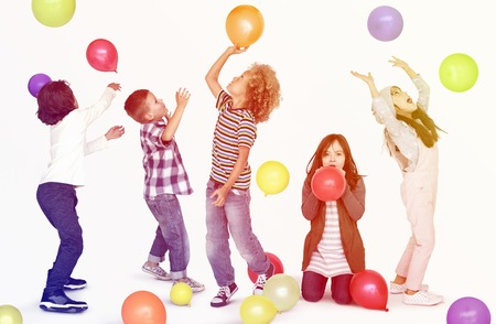 new age: Young children playing with balloons Stock Photo
