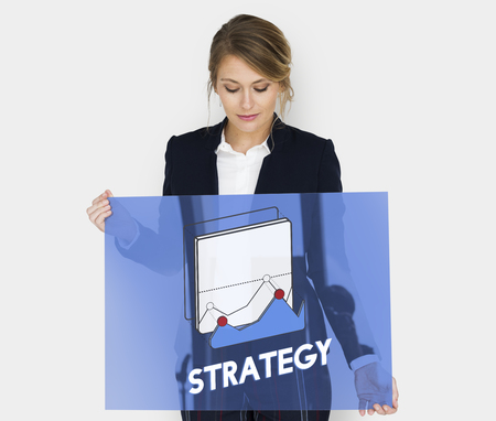 Businesswoman holding a board with strategy