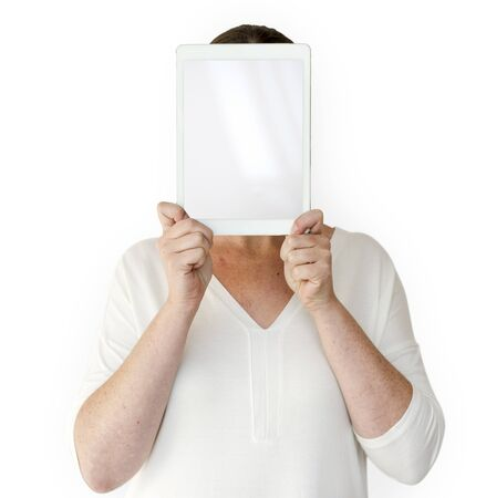 Woman holding blank digital tablet cover face studio portrait