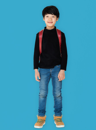 Young asian kid student with a backpack full body portrait Standard-Bild