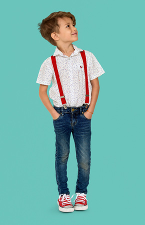 A Caucasian Boy Standing Looking Up Background Studio Portrait Stock Photo