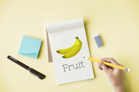 Illustration of fresh organic delicious banana on digital tabet Stock Photo