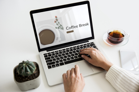 beginnings: Illustration of coffee cup decoration cafe commercial on laptop Stock Photo