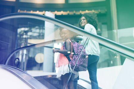 Little Girls going up by escalator
