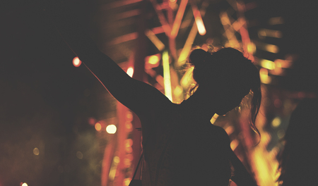 Woman dancing night club party