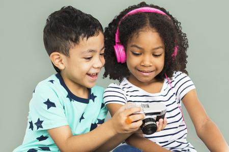 techie: Little Boy Show Camera Little Girl Earphone