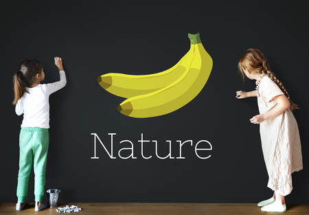 Children with illustration of fresh organic delicious banana Imagens