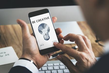 Graphic of creative ideas digital technology light bulb on mobile phone