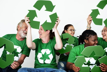Ecology group of people smiling and holding recycle symbol