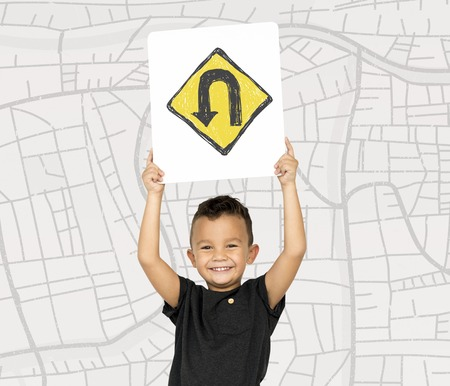 Young boy holding network graphic overlay banner Stock fotó