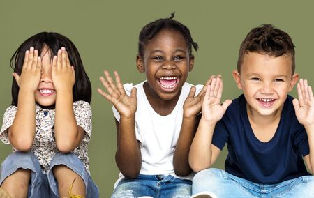 Group of happiness little children sitting on the floor Banco de Imagens - 82818485