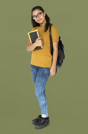 Indian girl student smiling and holding textbook Stock Photo - 82905570