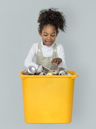 Little Girl Separating Recyclable Metal Can Studio Portrait 版權商用圖片 - 82761103
