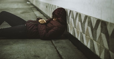 Homeless Woman Sleeping on The Floor