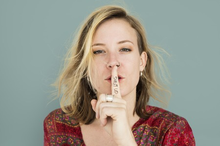 Caucasian Lady Hand Gesture Shut Up Stock Photo - 82862900