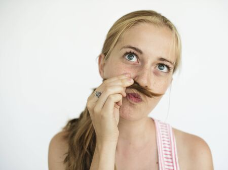 puckered lips: Young girl pretending to have a mustache