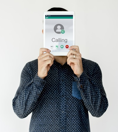Man holding network graphic overlay digital device covering face 版權商用圖片