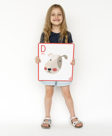 Happiness school kid smiling and holding alphabet animal placard