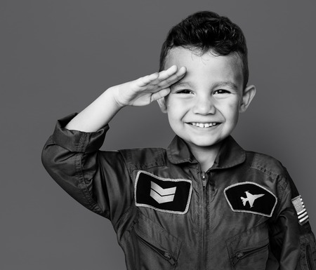 Little boy with pilot dream job salute and smiling Banco de Imagens - 82936066