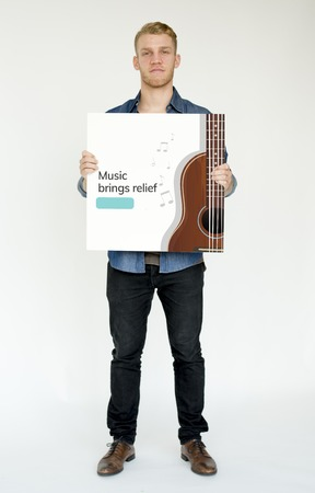 bass relief: Music concept card holding by people Stock Photo