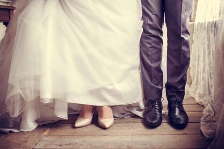 Couple take an abstract wedding shoot at legs Imagens
