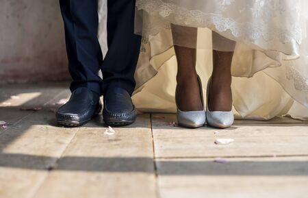 Bride and Groom Feet Standing on Wooden Floor