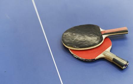 Table tennis racket on table sport