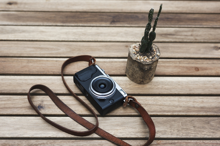 Film camera old vintage classic on wooden table