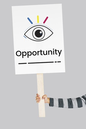 opportunity sign: Hand holding banner network graphic overlay Stock Photo