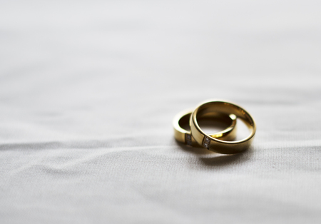 Two Gold Wedding Ring on White Background