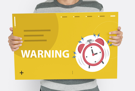 Man holding banner of alarm clock notification for important appointment Stock Photo
