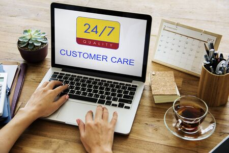 hotline: Hands holding digital device with 247 service