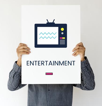 Man holding banner of TV broadcast media entertainment