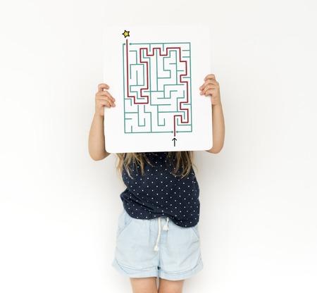 People hold puzzle concept card Фото со стока