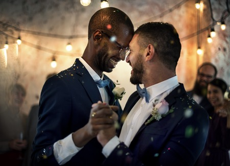 Newlywed Gay Couple Dancing on Wedding Celebration Foto de archivo