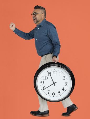 Caucasian Man Rushing Clock Imagens