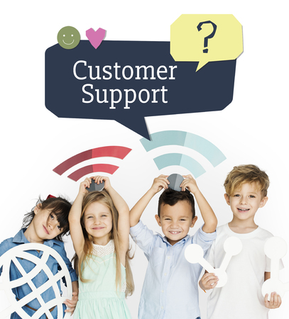 faq's: Group of kids with social network icon with smiling Stock Photo