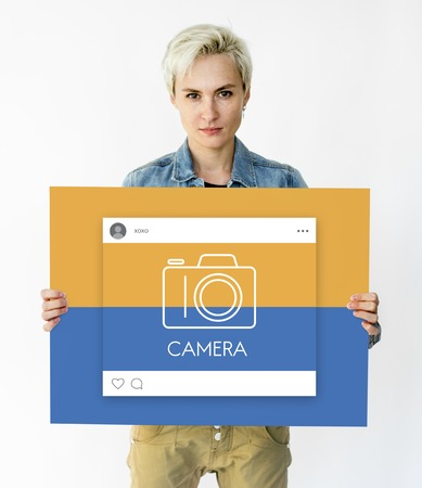 People holding placard with camera icon Stock Photo