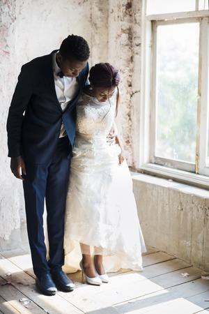 Bride and Groom Standing on Wooden Floor