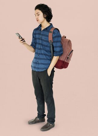 Young man full body using smart phone Stock Photo