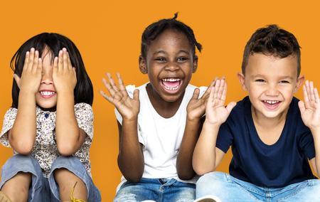 Group of happiness little children sitting on the floor Banco de Imagens - 83024763