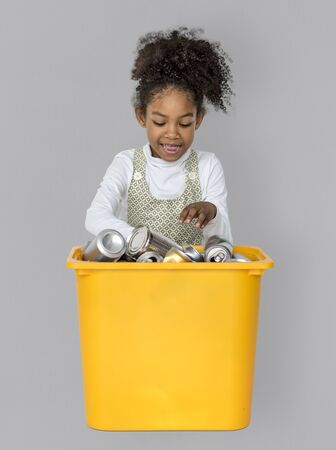 Little Girl Separating Recyclable Metal Can Studio Portrait