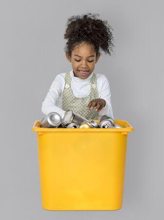 Little Girl Separating Recyclable Metal Can Studio Portrait 版權商用圖片 - 83024818