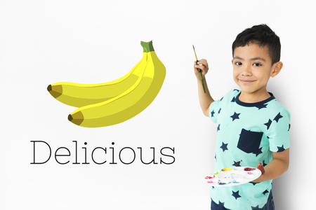 little boy with illustration of fresh organic delicious banana