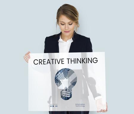 Woman holding banner of creative ideas digital technology light bulb