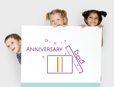 Group of children with illustration of happy anniversary gift box present