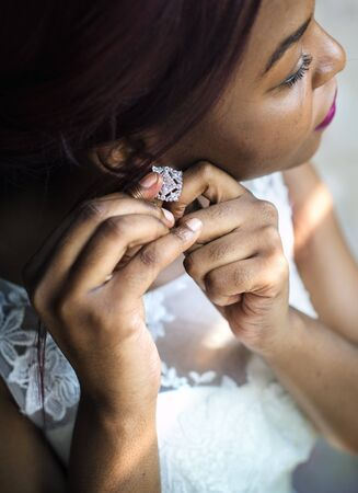 earing: Bride Wearing Earing on Wedding Ceremony Preparation Stock Photo