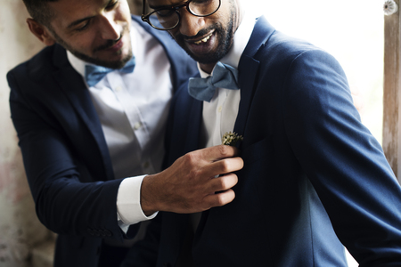 Gay Couple in Navy Blue Tuxedo Sitting Together Imagens